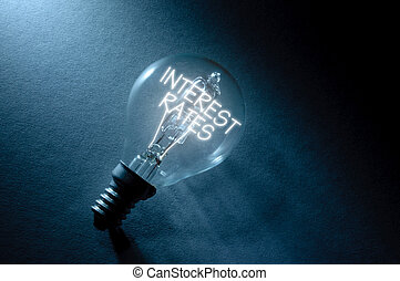 Interest rates - Bulb with interest rates lit up inside