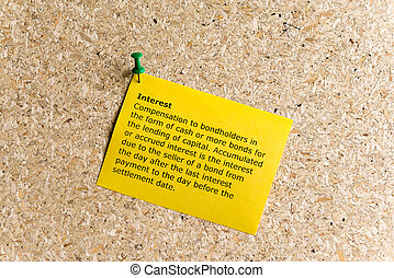 interest word typed on a paper and pinned to a cork notice board