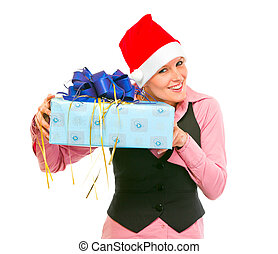 Interested business woman shaking present box trying to guess what's inside isolated on white