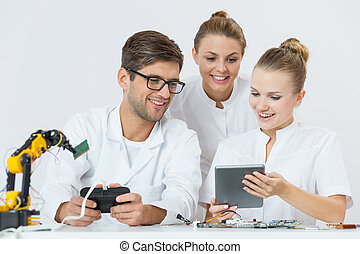 Interested in up-to-date technology - Shot of three young ...