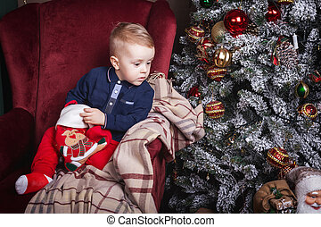 interested little boy holding a christmas stocking