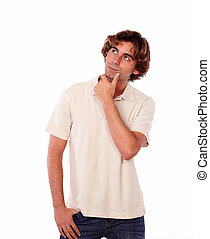 Portrait of an interested man reflecting alone while standing on white background - copyspace