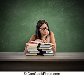 A young teacher concentrated reading a book