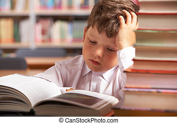 Interesting book - Image of interested schoolkid reading ...