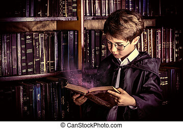 interesting book - Smart boy stands in the library by the ...