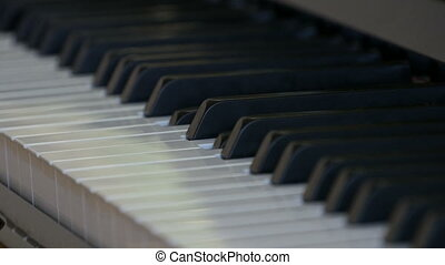 An interesting mystical self-playing piano. Black and white piano keys that play on their own