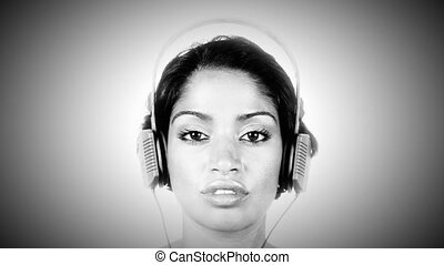 interesting shot of changing retro headphones on a woman's head. very disco