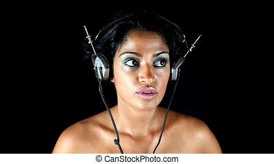 retro headphones on a woman's head. very disco