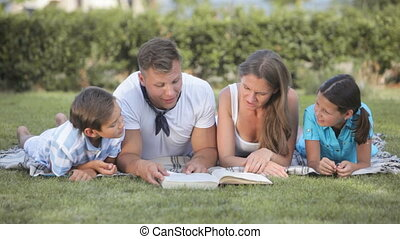 Interesting story - Dad reading an interesting story to his...