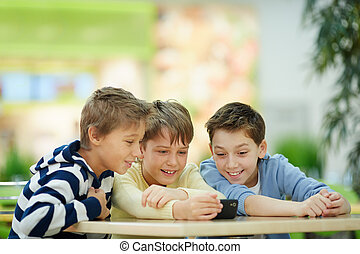 Interesting video - Three boys absorbed in smartphone screen