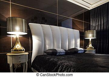 Interior bedroom bed in dark colors