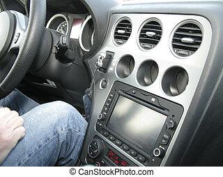 Interior car - Hand en legs in jeans in behind steering...