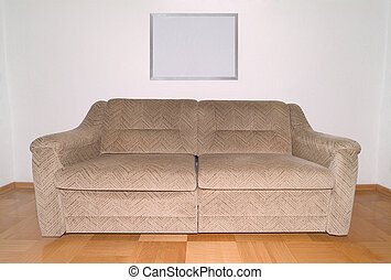 Interior - Couch - Couch on wooden tile floor with an empty...