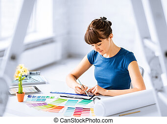 woman working with color samples for selection - interior ...