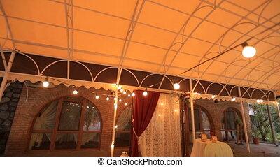 Interior design. Decorative lighting. Fluorescent lights in a restaurant