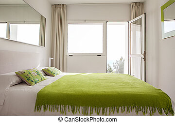 Interior design in bedroom of pool villa with cozy king bed. Bedroom with green and white colors