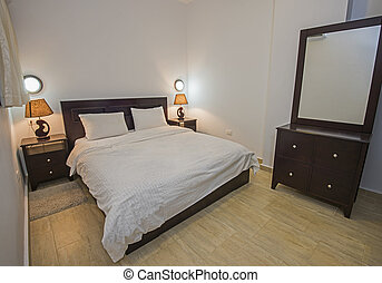 Interior design of bedroom in apartment