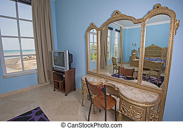 Interior design of bedroom in villa with dressing table