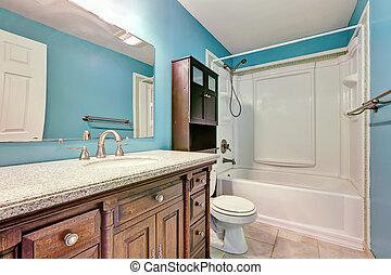Interior design of blue bathroom in apartment