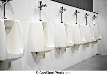 Interior Design of Men's Toilet - Row automatic urinals in a...