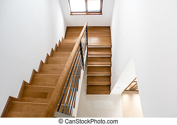Interior design. Wooden minimalist staircase in luxury home. Modern Architectural loft with wooden steps