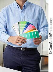 Interior Designer Holding Color Swatches