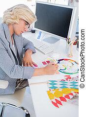 Interior designer looking at colour charts