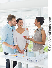 Interior designer speaking with happy clients