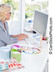 Interior designer working on her computer
