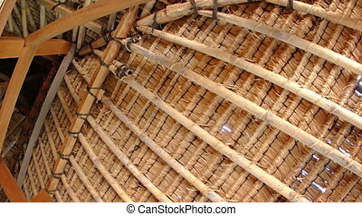 Interior details of traditional, thatched roof in Indonesia....