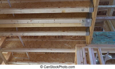 Interior framing beam of new house under construction home...