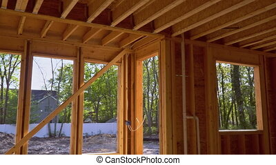 Interior framing beam of new house under construction home framing