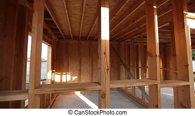 Interior framing of a new house under construction -...