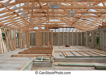 Interior framing of new home - Block home with roof trusses ...
