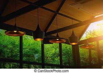 Interior lighting decor in coffee shop. Vintage tone
