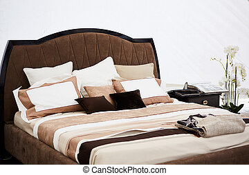 Interior of a bedroom in brown tones.