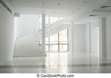 Interior of a building with white walls - Interior of a ...