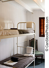 Interior of a cabin of a vintage steamship - Bunkbeds in a...
