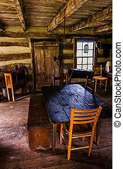 Interior of a historic log cabin in Sky Meadows State Park, Virginia.