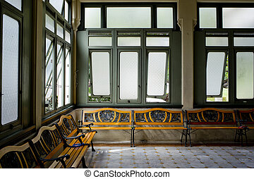Interior of a hospitall waiting room with a view on windows. Day