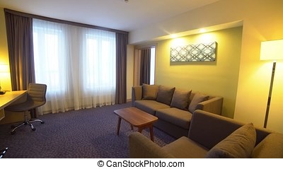 Interior of a hotel room, living room.
