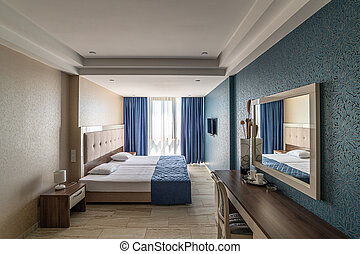 Interior of a hotel room with two beds