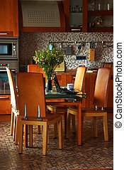 Interior of a kitchen with wooden table and chairs
