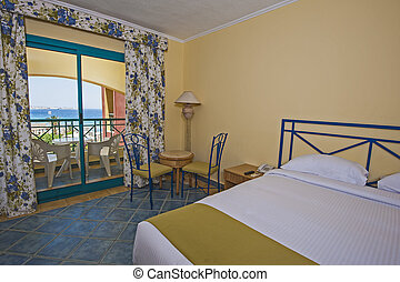 Interior of a luxury hotel room with balcony