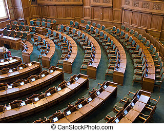 Interior of a parliament senate hall full of seats and work desks