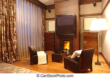 interior of a room with fireplace and big window
