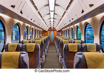 Interior of a train with empty seats. Modern train seats.