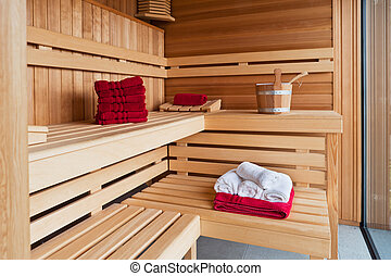 Interior of a wooden sauna with bath towel