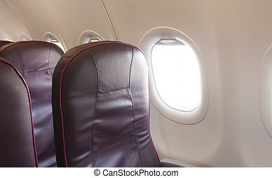interior of airplane with chair and white window