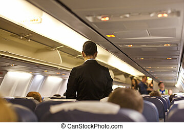Interior of airplane with passengers and stewardess walking...